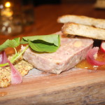 Pork terrine with house mustard, mango pepper jam and pickled pearl onions.